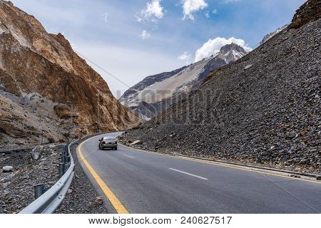 Country Road Landscape In Northern Pakistan, And A Car Driving On The Road