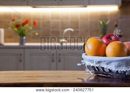 basket full of fruits on kitchen table