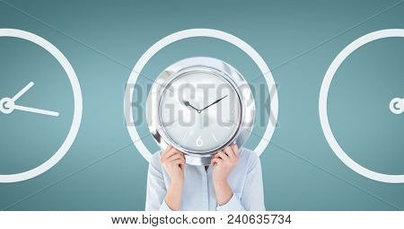 Business woman holding a clock against background with clocks