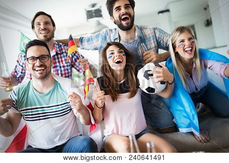 Group Of Multi-ethnic People Celebrating Football Game And Having Fun