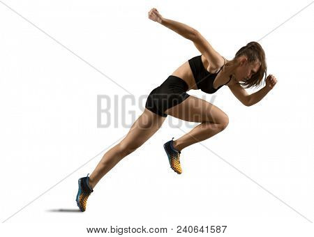 Woman sprinter leaving starting on the athletic track. Exploding start