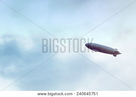 Dirigible Flying In Cloudy Sky, Overcast Skyscape With Airship