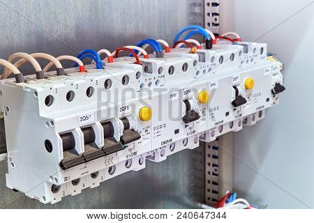 A Range Of Different Modular Electrical Devices In An Electrical Cabinet. Circuit Breaker, Protectio