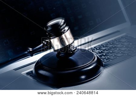 Computer web legal issue concept image, gavel on laptop computer