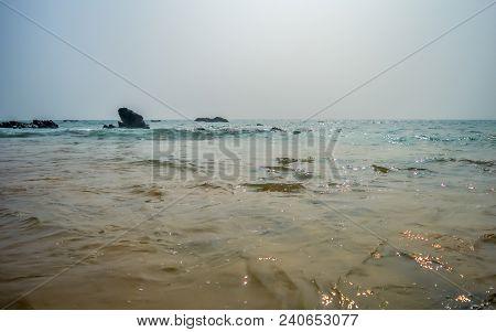 Beautiful Rocky Sea Shore At Sunrise Or Sunset Wild Empty Tropical Beach, Bright Blue Sky, Crystal C