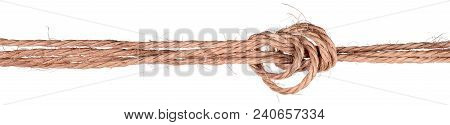 Knot In A Twisted Jute Rope Isolated On White Background