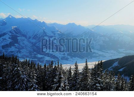 Sunset In The Alps. Sunset In The Snow-capped Mountains Of The Austrian Alps On A Cold Blue Sky Wint
