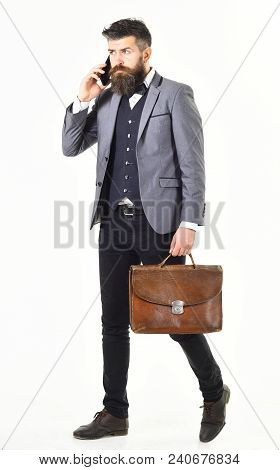 Busy Man Concept. Bearded Man Talking On Phone And Looking Busy.