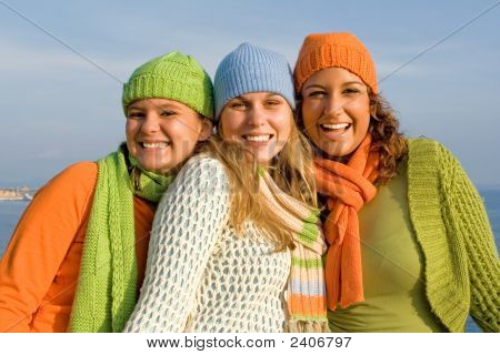 happy smiling group of girlfriends with hats and scarves poster