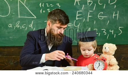 Mathematics Lesson Concept. Father Teaches Son Mathematics. Teacher In Formal Wear And Pupil In Mort