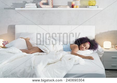Young African American Woman Waking Up At Home. Portrait Of Happy Black Girl Smiling, Enjoying A Lar