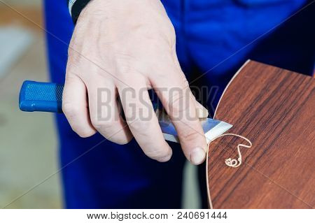 A Professional Carpenter Processes The Plastic Edges Of The Countertop With A Knife-edge Cut. The Co