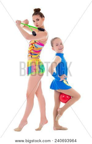 Young Beautiful Slim Woman And Little Girl Doing Gymnastics With Maces And Ball Isolated On White Ba