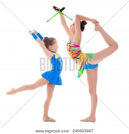 Beautiful Slim Woman And Little Gitl Doing Gymnastics Isolated On White Background