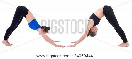 Two Young Women Standing In Yoga Pose Isolated On White Background