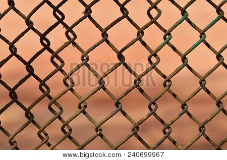 A Fence Made Of Iron Net.the Wire Is Twisted Into A Rigid Mesh .