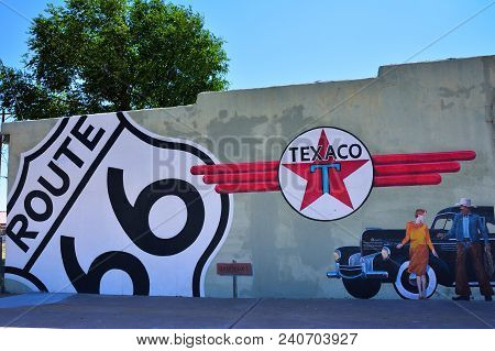 Tucumcari, New Mexico - July 21, 2017: Texaco Gas Station In Tucumcari, Showing An Old Chrysler, The
