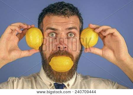 Vegetarian, Health And Wellbeing. Dieting And Fitness. Man With Long Beard Eat Lemon. Fruit And Heal