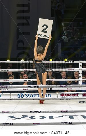 Brovary. Ukraine, 14.11.2015 Long-haired Ring Girl Stands With Her Back Inside The Boxing Ring And H