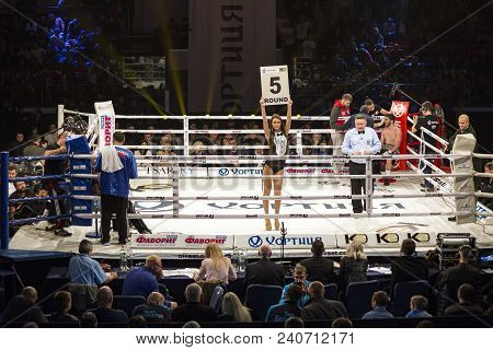 Brovary. Ukraine, 14.11.2015 Ring Girl Stands Inside The Boxing Ring And Holds A Plate With The Insc