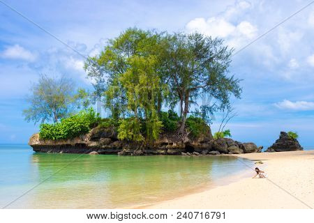 Beach with rocky landscape in Aru island, Papua, Maluku, Indonesia