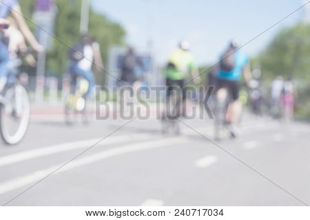 Group Of Cyclist Cycling Back To Us On The Road In The Countryside. Blurred Motion Background, Copy