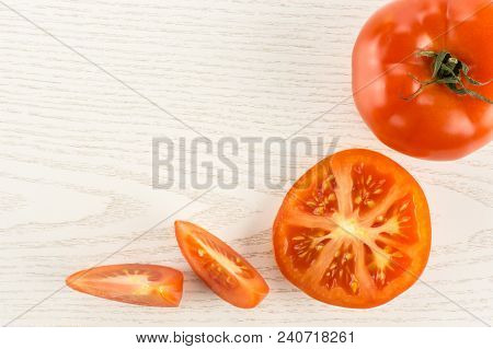 Red Tomato Collection Isolated On Grey Wood Background Top View One Whole One Section Half And Two S