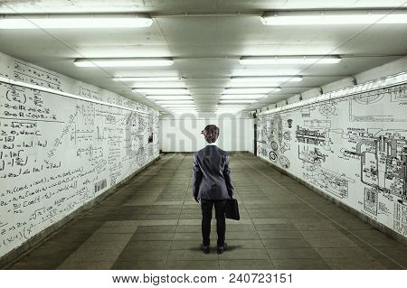 Businessman Go Through A Tunnel With Walls Full Of Mathematical Formulas And Sketches.