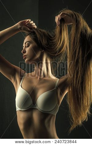 Haircare And Shampoo. Woman With Stylish Long Hair In Underwear. Beauty Salon And Fashion. Girl Has