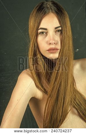 Woman With Stylish Long Hair And Naked Chest. Girl Has No Makeup And Healthy Hair On Black Backgroun