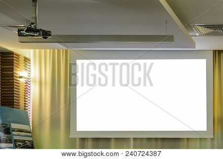 Projector In A Room With Projector Screen On Back Ground.