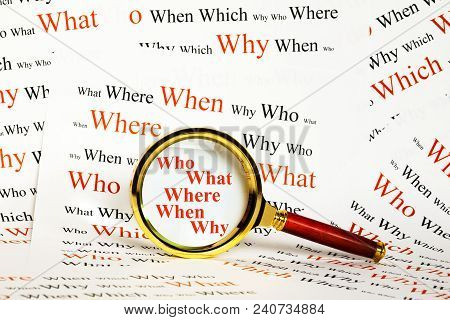Information  Concept - Magnifying Glass Over The Words Who What Where When Why, With A Background Of