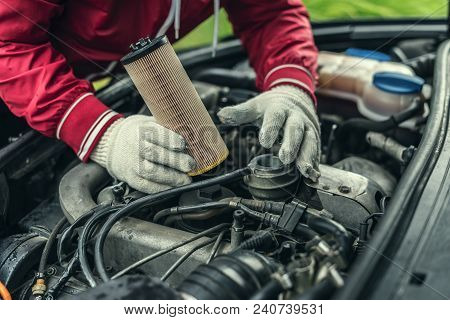 The Auto Mechanic Replaces The Car's Oil Filter.
