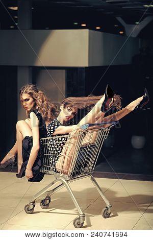 Shopping, Shop, Shopaholic. Women Shoppers In Shopping Cart, Trolley. Girls Fashion, Beauty, Look Ma