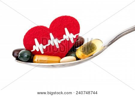 Colorful Medical Supplement And Drug Pills With Red Heart In Spoon , Pharmaceutical Cardiology Drugs