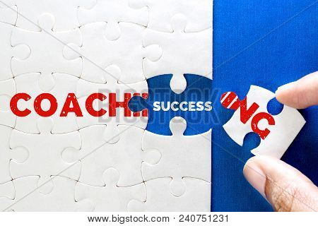 Close Up Piece Of White Jigsaw Puzzle With Coaching And Success Text , Concept Of Business Coaching