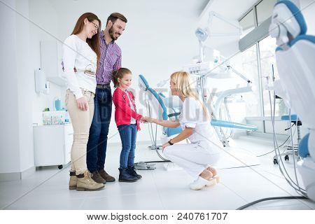 Family Visits Dentist In Dental Office