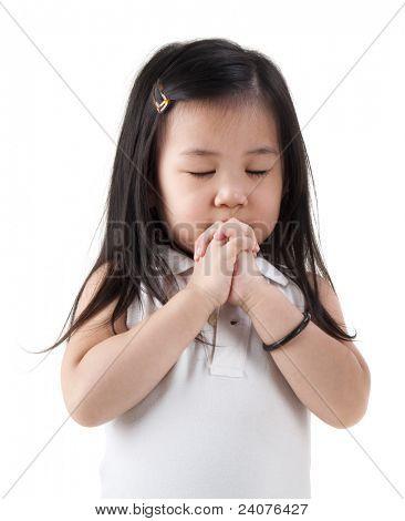 Little girl praying on white background