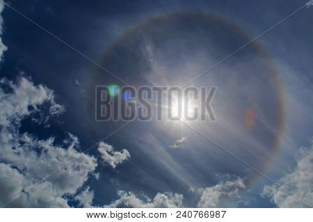 Sun Rainbow Halo. Halos Are Atmospheric Phenomena Created By Light Which Is Reflected Or Refracted B