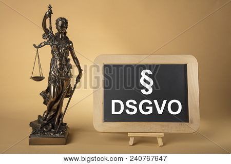 Justizia Figure With Board Dsgvo  On Beige Background