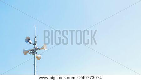 Outdoor Loudspeaker Alert System Against A Blue Sky