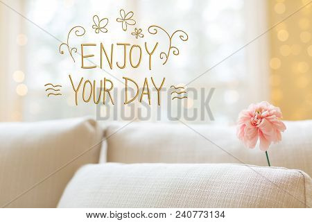 Enjoy Your Day Message With A Flower In A Bright Interior Room Sofa