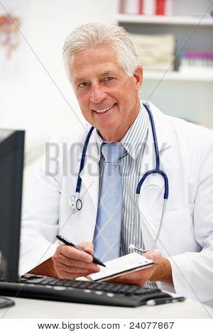 Senior doctor at desk