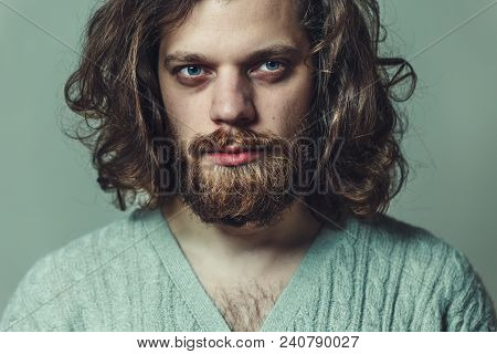 Handsome Brutal Man With A Beard And Long Hair. Creative Headshot Portrait