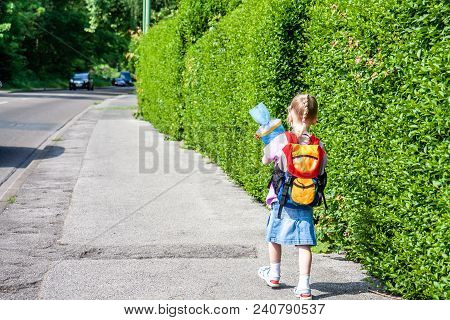Little Girl On Her Way To Her First Day Of School.