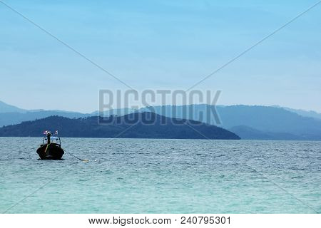 Fishing Boats Parked In The Sea On A Bright Day.