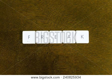 Freak Word Written On Plastic Keyboard Alphabet With Dark Background
