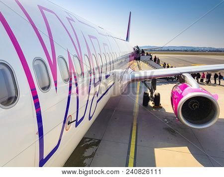 Gdansk, Poland - April 13, 2018: Wizz air plane on Lech Walesa Airport in Gdansk, Poland. Wizz air is a low-cost airline with largest fleet in Hungary who serves over 30 countries.