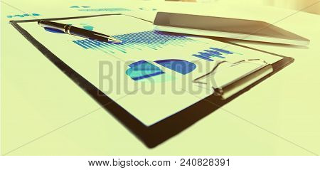 Close-up Of Business Document In Touchpad Lying On The Desk, Office Workers Interacting In The Backg