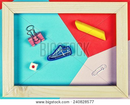 Style Minimalism.abstraction, School Supplies In A Frame On A Multi-colored Paper Background. Back T